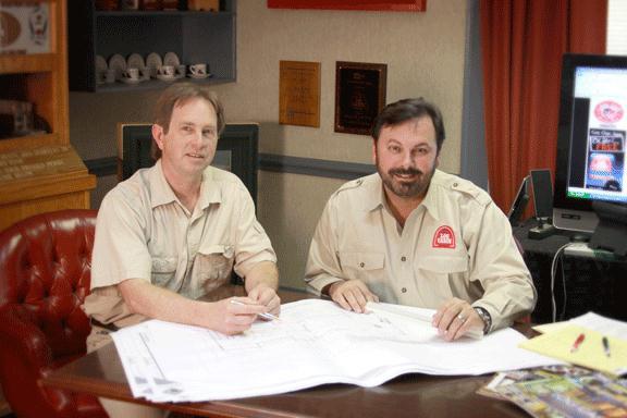 Tom Vesce & Murray Arnott reviewing resort plans.